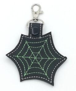 spinnenweb sleutelhanger groen